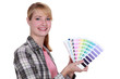 Woman holding up colour samples