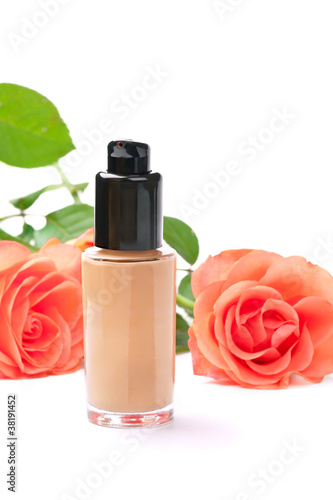 Natural cosmetics concept: foundation cream with roses, on white