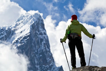 Woman hiking in mountains, success concept