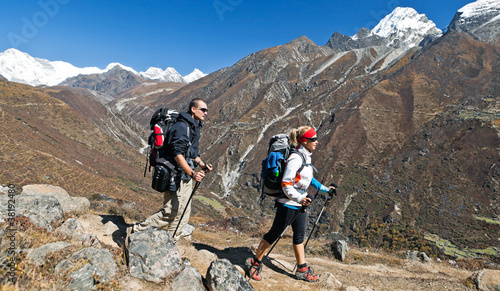 Young people hiking in mountains