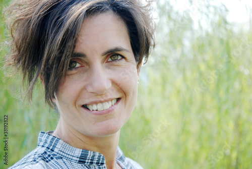 face of young woman smiling and nice outdoor portrait
