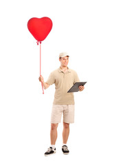 Delivery boy delivering a red heart shaped balloon