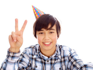 smiling boy with party hat