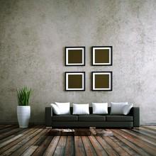 Home Design - czarna skórzana kanapa przed betonową ścianą