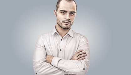 Fashion young businessman on gray background