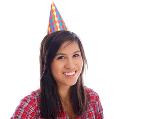 smiling teenage girl with party hat