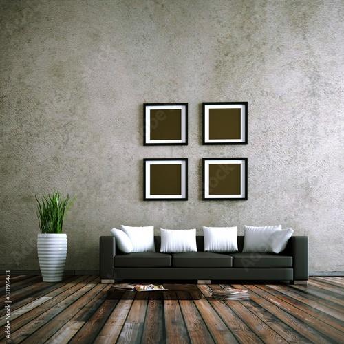Wohndesign - schwarzes Ledersofa vor Betonwand