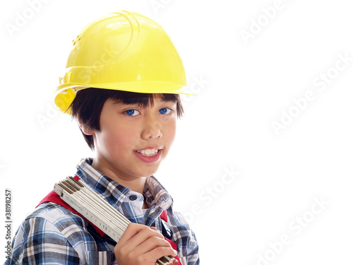 smiling boy wearing construction helmet