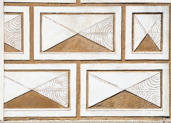 Fragment of a renaissance house wall decorated with sgraffito