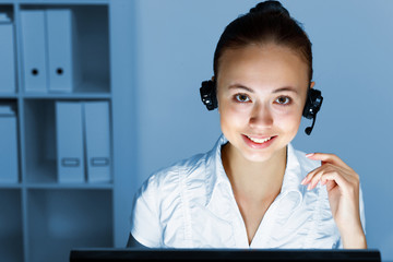 Young woman in business wear and headset