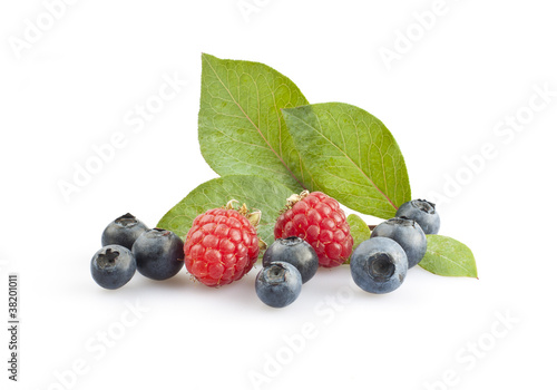 Blueberries and raspberries isolated on white