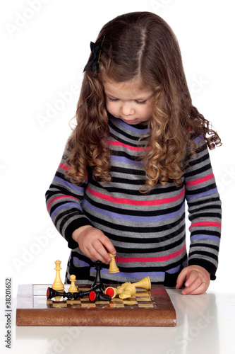 Adorable baby girl playing chess Poster