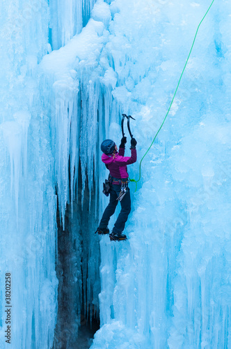 portrait of woman climbing ice