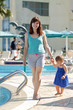 happy mother with  toddler  walking  at resort