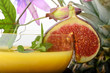 Orange juice decorated with fig and mint