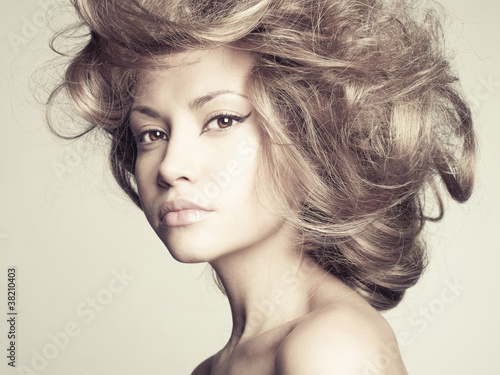 Beautiful woman with magnificent hair - 38210403