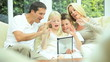 Young Family Using Wireless Tablet for Webchat