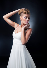 Portrait of romantic blonde young bride. Studio shot