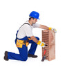 Worker laying bricks - isolated