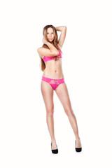 Sexy young woman posing in a bikini.