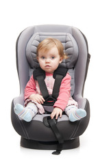 girl sitting on child's car seat