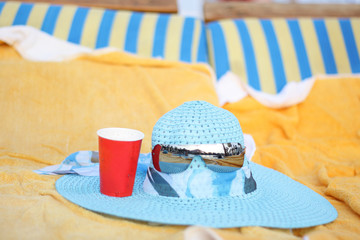 Summer blue hat and glasses on the lounge