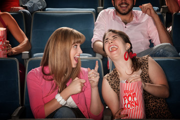 Women Laugh in a Theater