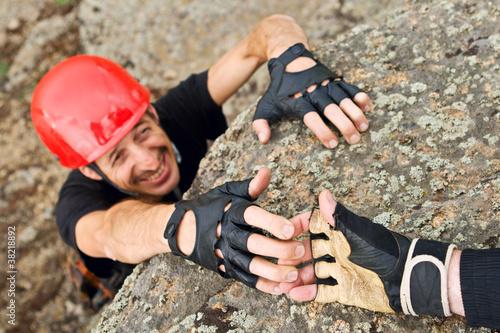 Climber Lending Helping Hand