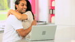 Asian Couple with Laptop Having Success Online