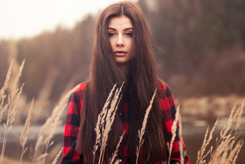 Beautiful girl posing in the grass