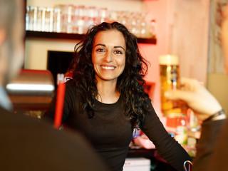 Pretty mediterranean looking bar-maid loves her job