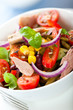 Bowl of mixed vegetable salad with tuna