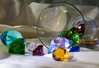 Overturned glass with colour gems