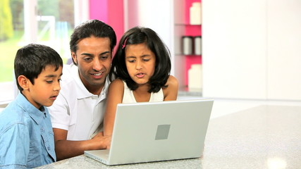Young Asian Father & Children Using Laptop