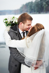 Lovers embrace the bride and groom