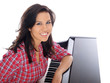 teenage girl leaning on the piano