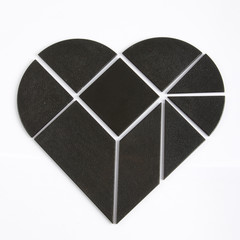 Black heart made of black puzzle pieces