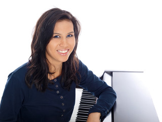 smiling teenage girl by the piano