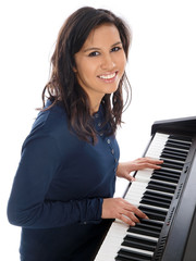 smiling teenage girl playing piano