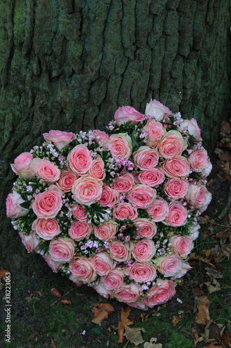 Pink sympathy flowers in heart shape