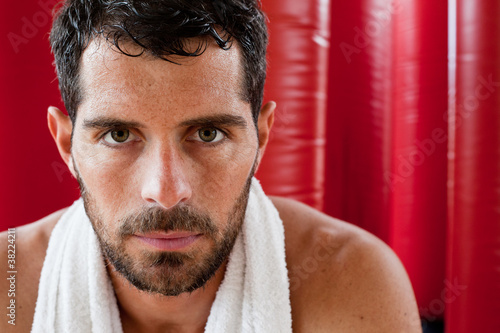 Close up portrait of a handsome man sweating