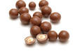 chocolate balls with nuts on a white background