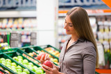 Fit Woman Buying Apples at Supermarket