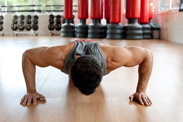 Muscular man doing push-ups