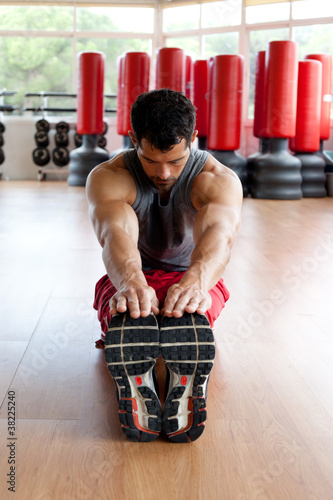 Muscular man stretching