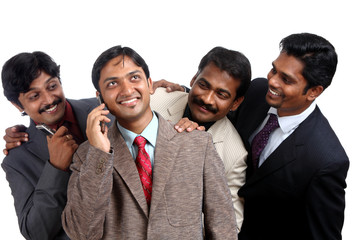 Indian young businesspeople talking in mobile