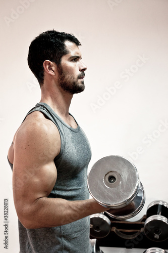 Handsome man lifting weights