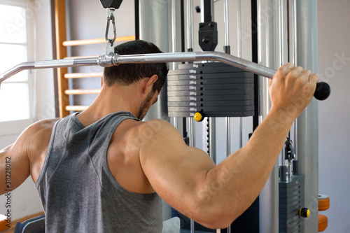 Muscular man lifting weights