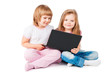 two smiling girls looking at laptop