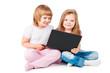 two smiling girls looking at laptop